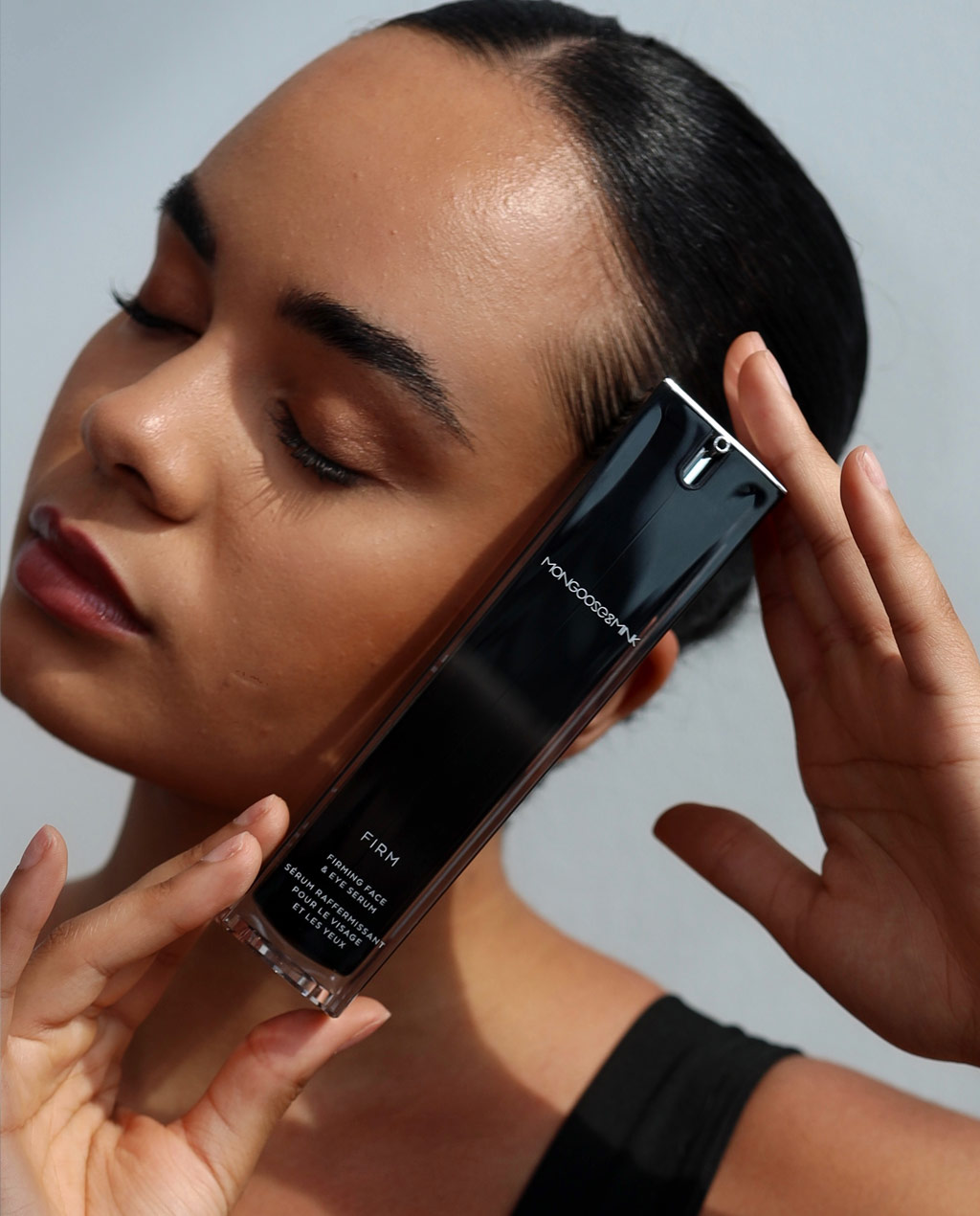 Model putting product next to face